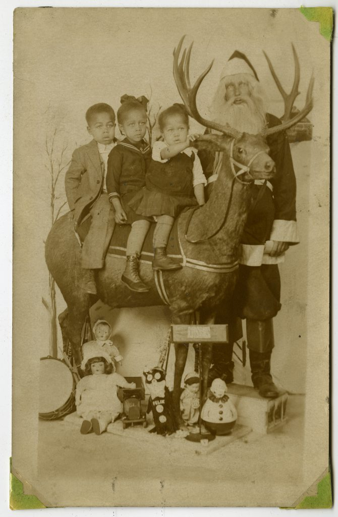 LeRoy Anthony, Thelma Anthony-Scott, and Ruby Anthony-Miller Visiting Santa Claus
