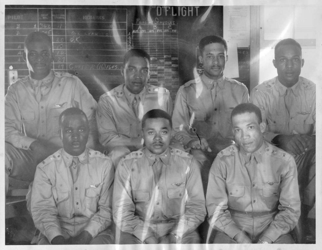 Seven members of Tuskegee Airmen class 42E pose in uniform